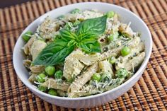 1/2 pound penne (I used whole wheat) 1 cup basil pesto 1/3 cup mayonnaise 1 cup peas 1 cup artichoke hearts (quartered) parmigiano reggiano to taste (grated)