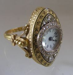 Antique gold watch ring ca 1860 with enamel and diamonds.Key wind movement. Probably French