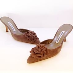 Manolo Blahnik brown suede mules with flower detail at toe. Please call (949)715-0004 for inquiries.