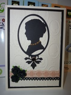 My female card using cameo from heritage cricut cartridge.