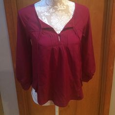 American Eagle blouse. Size XS Perfect for holiday parties!  Wine colored blouse is 100% polyester. Loose fit style. Single button close at neck with attached ties. Cross over back. Never worn. American Eagle Outfitters Tops Blouses
