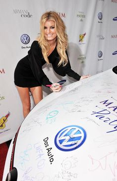 GTI is signed by model Marisa Miller at the 2010 Maxim Party at The Raleigh on February 6 2010 in Miami Florida VW a sponsor of the 2010 Maxim...