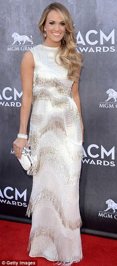 All white on the night: Carrie Underwood went for a bridal inspired fringed white dress for one of country music's biggest nights