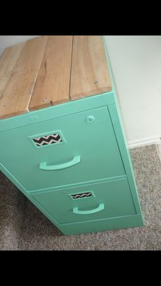 Upcycle an old filing cabinet. Like the idea to add wood to top of this filing cabinet, makes it look more like a piece of furniture