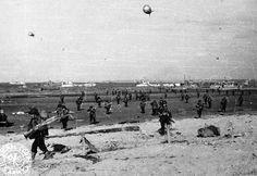 U.S. soldiers land on Utah Beach, June 1944. (Regional Council of Basse-Normandie/U.S. National Archives)