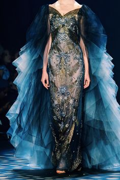 This dress is a piece of art. Blue, bronze and gold detail and blue ombre on the back. Speechless!