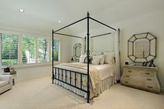 For an elegant, slim look, a wrought iron four poster bed is a wonderful addition to the space. If you prefer not to have a full canopy on your bed, you can simply place a few smaller curtains, as shown in this bedroom