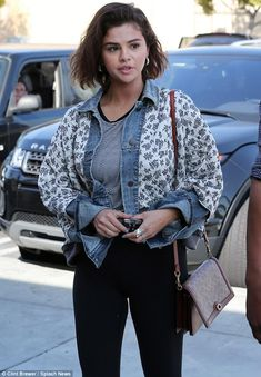 Keeping cozy; The Texas-born 25-year-old pop act layered up, pulling a pearl-grey-and-navy floral jacket with diamond stitching over an open denim shirt