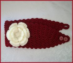 Free Valentine Romance Headband Crochet pattern - this can be made with or without the flower. I like a headband pattern that gets narrower where it goes under your hair. I also like the buttons but am afraid they'll get tangled in my hair.