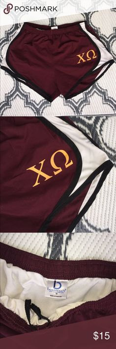 CHI OMEGA sorority athletic shorts ladies medium CHI OMEGA college sorority athletic shorts ladies medium. Maroon shorts with gold Greek letters on front. Full lining. Good condition! Bundle with another item from my closet for a discount! **not Nike brand** Nike Shorts