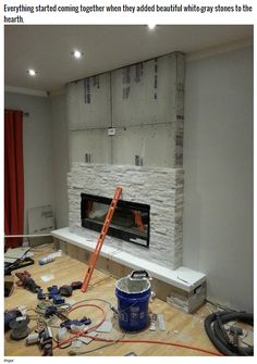 Stacked Stone Fireplace see how to transform the blank wall into favorite part of the