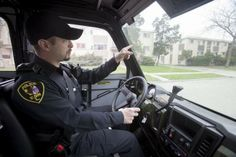 Officer John Varga, a member of the Resident Officer Program of Elgin, points to apartment complexes near Mulberry Court on Wednesday, April...