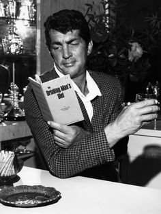 Dino Martino with a drink and a book
