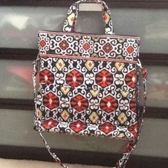 Foldover crossbody to tote bag Convertible bag. Two cell phone pockets, one zip pocket,  two pen pockets, adjustable strap, magnetic closure, two exterior pockets. NEVER USED IT Vera Bradley Bags Totes