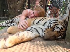 Cuddled with a tiger. Oh yes I did.