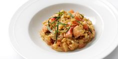 Native lobster risotto with tarragon and chives  by William Drabble
