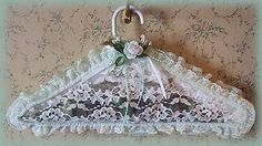 Potpourri-Filled Lace Clothes Hanger. No sewing required - just load up your glue gun and go! When the potpourri scent fades, replenish it with a spray of your favorite perfume or by sprinkling a few drops of essential oil or fragrance oil through the lace to infuse the potpourri.