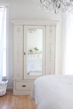 Eclectic Bedroom by Dreamy Whites :: <3 the wardrobe, chandelier & pop of mossy green in the reflection. All white spaces are so calming to me. | #bedroom #white