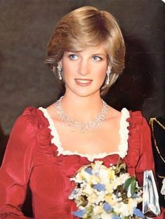 Princess Diana in a red silk gown designed by Belville-Sassoon