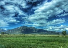 North Of Taos Greeting Card featuring the photograph North Of Taos, New Mexico Mountains by Debra Martz