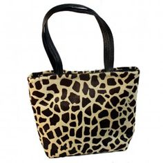 """Giraffe Stamped Hair on Cowhide Tote Brown leather handles. Interior with 3"""" leather top and vintage orange and yellow linen lining. One leather zippered interior pocket and 2 open hand beaded, fabric pockets. Leather strap with brass toggle for easy to find keys. Magnetic closure. 18""""wide x 12"""" high with 5"""" soft bottom."""