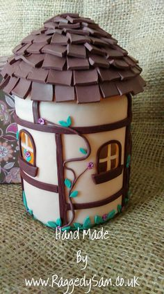 Polymer clay Fairy house night light, made using polymer clay to coat a glass jar, a battery operated tea light candle is used to give a pretty lighting effect.
