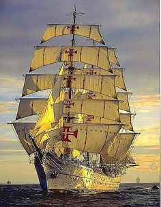 Portuguese tall sails ship 'Sagres' sailing into Lisbon harbour at the dawn.