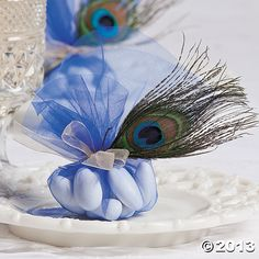 Tulle & peacock feather wedding favors. Matches your peacock idea.
