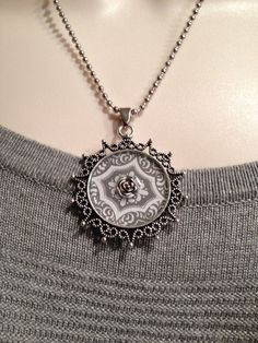 A personal favorite from my Etsy shop https://www.etsy.com/listing/233162387/vintage-flower-rim-pendant-tray-necklace