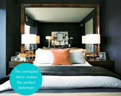Mirror Images…no headboard...no worries...oversize mirror reflects art on opposite wall and could really lighten up a room