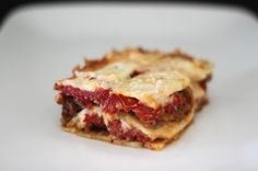 If lasagna is comfort food that you just can't quit thinking about, then pull out that lasagna pan because this recipe is going to make you really happy. Even the most carb-addicted, pasta-loving person you know will be hard pressed to admit that this Primal lasagna isn't delicious. This lasagna is the real deal – minus the noodles, of course. In place of noodles are thin sheets of celery root, a vegetable with a mild flavor and tender texture that does a fine job of impersonating a lasagna…