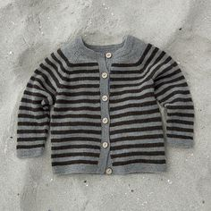 sweater pattern by Susie Haumann. i love using non-baby colors in kid knits.