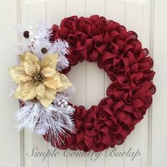 Stunning red burlap wreath accented with white pine spray and a gold poinsettia #afflink