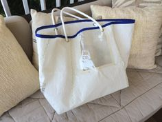 Sail cloth bag. Made out of recycled sali clothI used the part with the transparent window to create a fun effect on the bag
