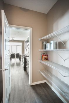 Porchlight Developments is a new home builder that focuses on building amazing communities in Regina and Winnipeg New Home Builders, Pantry, The Neighbourhood, New Homes, Building, Home Decor, Pantry Room, Homemade Home Decor, Butler Pantry