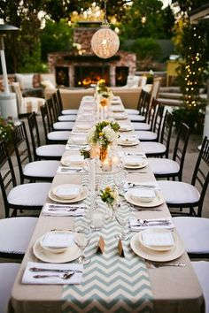 Beautiful, long wedding reception table in black and white with a paper lantern