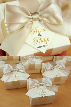 Elegant Ivory & Champagne wedding party favor gift box with satin ribbon bow and names. Personalized wedding bonbonniere make great packaging for your favors and a unique way to thank guests for attending your big day Champagne Wedding Favors, Wedding Candy Table, Custom Wedding Favours, Wedding Gifts For Guests, Wedding Favor Boxes, Personalized Wedding Favors, Wedding Party Favors, Wedding Decorations, Wedding Door Hangers