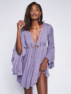Romeo Mini Dress | Lightweight and easy mini dress featuring a plunging neckline and front tie at the bust with an elastic band for an easy fit. Sheer crochet detailing throughout. Dramatic flared cuff on the three-quarter length sleeves and a hidden side zip. Lined.