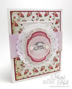 A darling baby girl card by Sheri Holt using products by Carta Bella, Spellbinders and JustRite, all available at The Stamp Simply Ribbon Store.