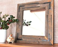 I want this mirror in a bigger size for my birthday (Corey, let's talk)...Rustic Industrial Eco Decor Reclaimed Wood Mirror by TheHoneyShack, $45.00