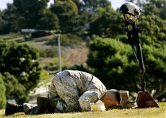 Sgt Dan Kryst kisses his brother's boots during a memorial service for Capt. Kevin M. Kryst who was killed on December 18 conducting combat operations in Al Anbar province of Iraq, on January 12, 2007 at Camp Pendleton, California.