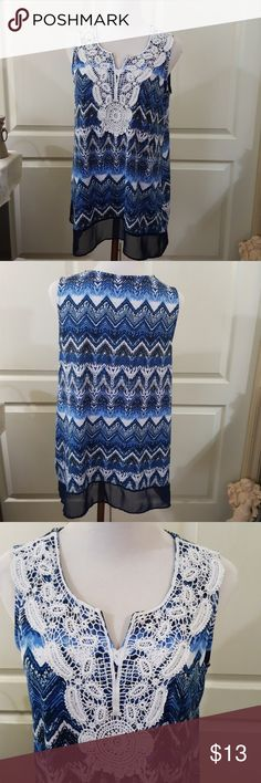 """Kim Rogers Sleeveless Blouse. Sz. Med/Lg Very nice sleeveless blouse by Kim Rogers in blues and white colors. No holes, stains, pilling, pulls, or other flaws. In very good condition. Pretty crochet detailing on front on cute sheer 3"""" sheer navy bottom. Tag says size Med. Comfortably fits sizes Medium and Large, in my opinion. Please see pics for approx. measurements. Kim Rogers Tops"""