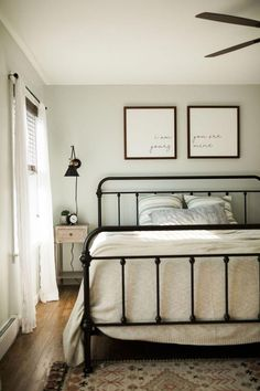 Boho farmhouse master bedroom Boho farmhouse master bedroom Boho farmhouse bedroom ideas with black iron bed frame, paint color silver feather by behr, sheer white curtains in bedroom and boho rug<br> Bedding Master Bedroom, Farmhouse Master Bedroom, Dream Bedroom, Home Bedroom, Bedroom Decor, Farmhouse Curtains, Spare Bedroom Ideas, Black Master Bedroom, Queen Bedding