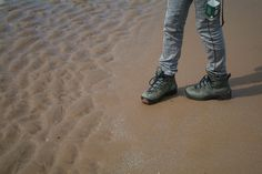 Destructive waves (and boots) erode the coastline in miniature. How much do you know about coastal processes?