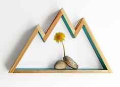 """This simple but striking mountain shelf is individually handmade from poplar wood to resemble a cluster of peaks from your favorite range. Choose from a variety of colors. Dimensions: 13.25"""" x 8"""" x 1."""