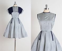 ➳ vintage 1950s dress    * blue/white print acetate  * front pockets  * button back  * rhinestone studded bodice  * matching bolero