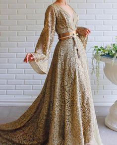 Apr 2020 - Details - Beige and Gold Color - Sparkling lace fabric - Leather belt detail - V-neck gown with long sleeves - For special occasions Pretty Outfits, Pretty Dresses, Fantasy Gowns, Royal Dresses, Beautiful Gowns, Dream Dress, Elegant Dresses, Designer Dresses, Ball Gowns