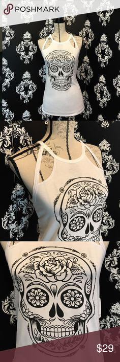 NWT! 🍀 Stylish Sugar Skull Tank! 💀 This tank is so cool with the Beautiful sugar Skull printed in black on this super light and slinky white tank! I love the way the tank is cut with its unique style! It's different and fun and perfect for summer! You can even color the skull with fabric markers to make it your own personal colors and style as well! Super fun! Brand new with tags! Smoke free home. Tops Tank Tops