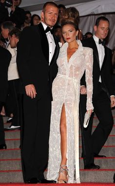 Pin for Later: How Victoria Beckham Went From Spice Girl to Style Icon Victoria Beckham Style Evolution Stepping out for the Costume Institute Gala in 2008, both the Beckhams go elegant and this time mix and match black and white.
