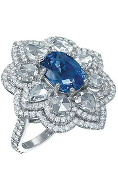 Flower 18k white gold sapphire and rose-cut diamond ring with double-row pavé diamonds;